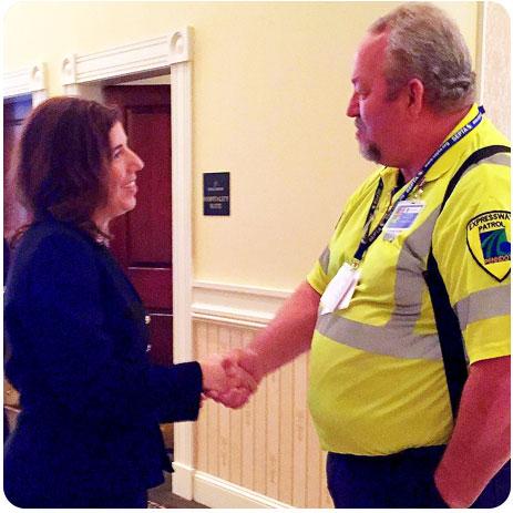 Acting Secretary of Transportation Leslie Richards speaks with a PENNDOT representative in attendance